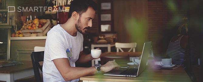 Man working at laptop inside coffee shop